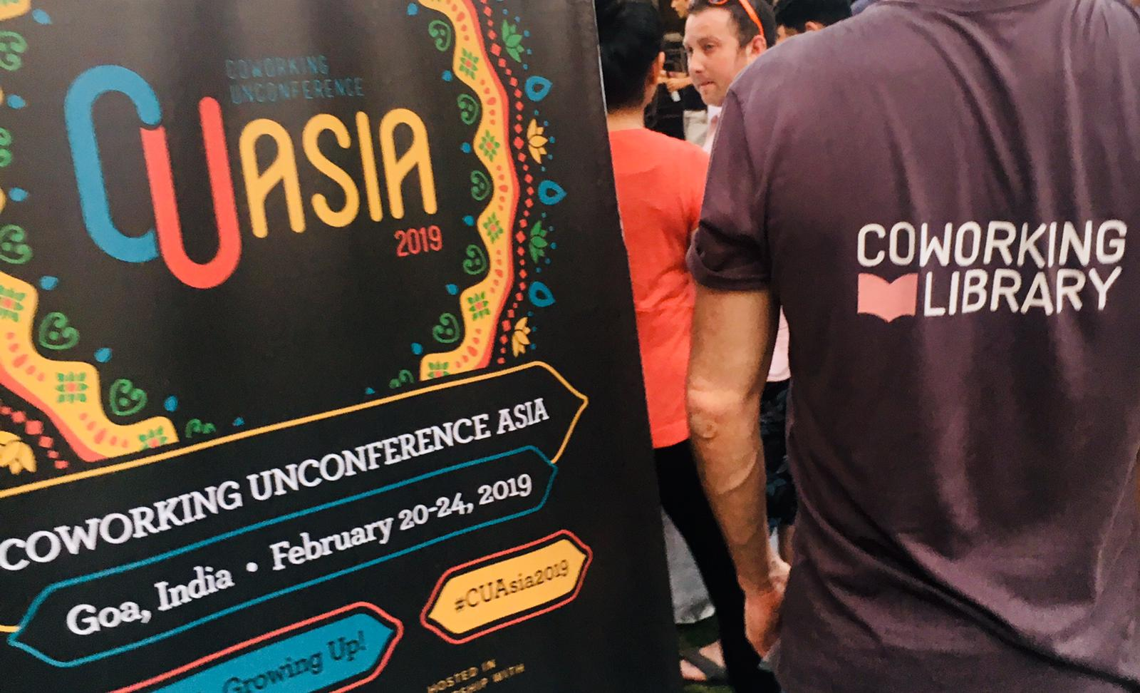 Banner of CU Asia 2019 and Carsten from behind with the Coworking Library Logo on his shirt